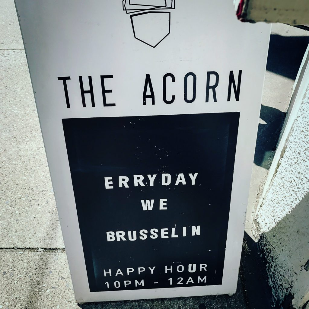 Sandwich board sign for the Acorn Restaurant on the sidewalk