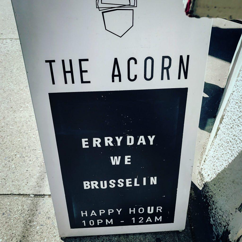 Sandwich board sign for the Acorn Restaurant on the sidewalk