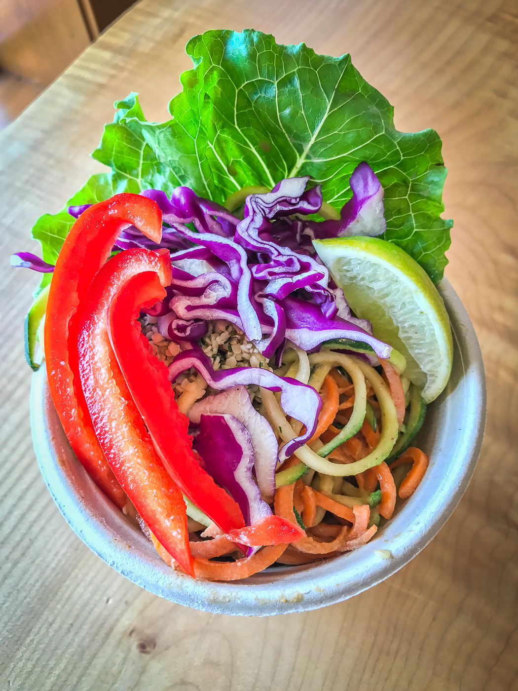 A small bowl filled with colorful vegetables