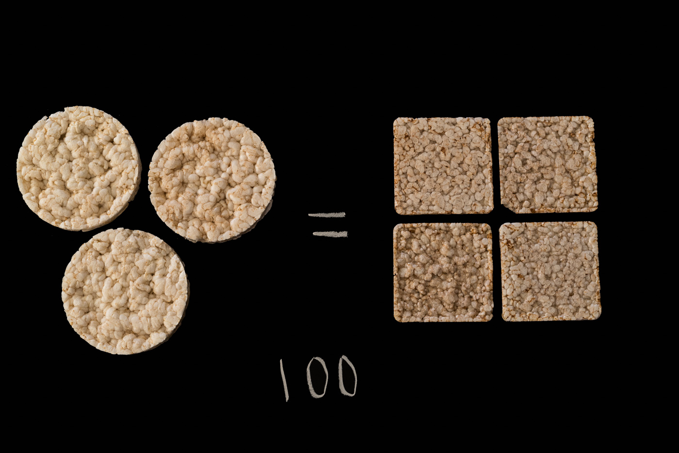 3 round rice cakes and 4 square rice cakes over the number 100 on a black background