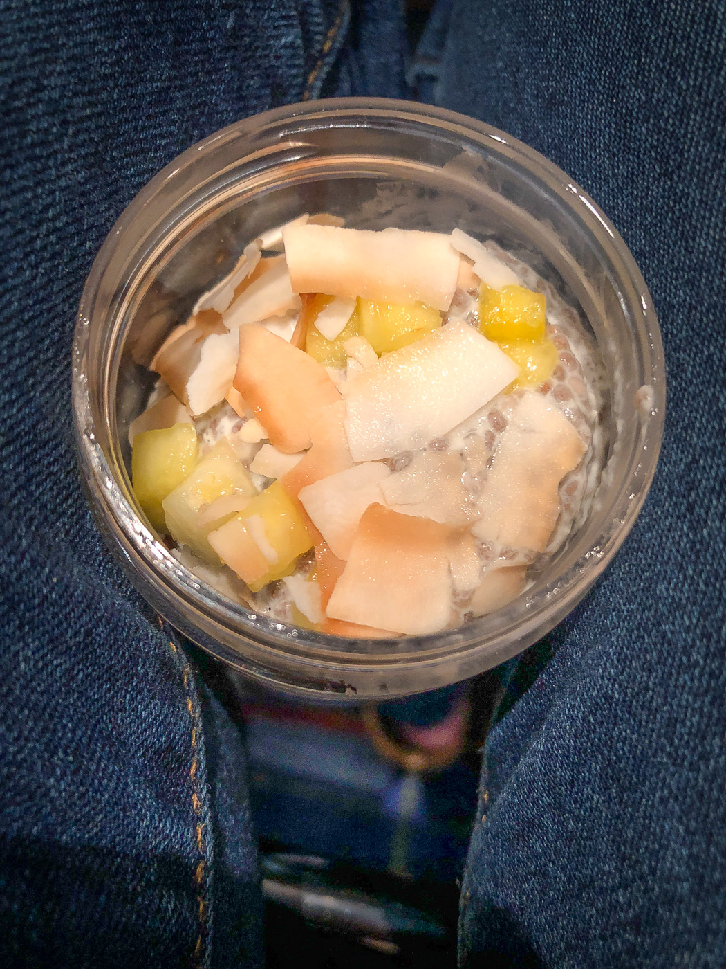 Container of Coconut Chia Pudding on lap