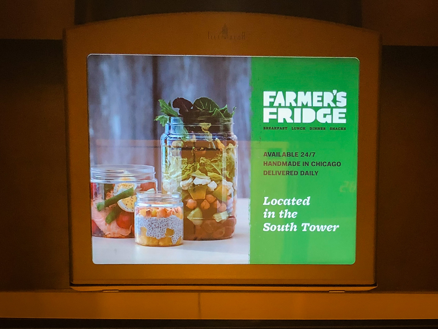Video screen in elevator showing ad for Farmer's Fridge