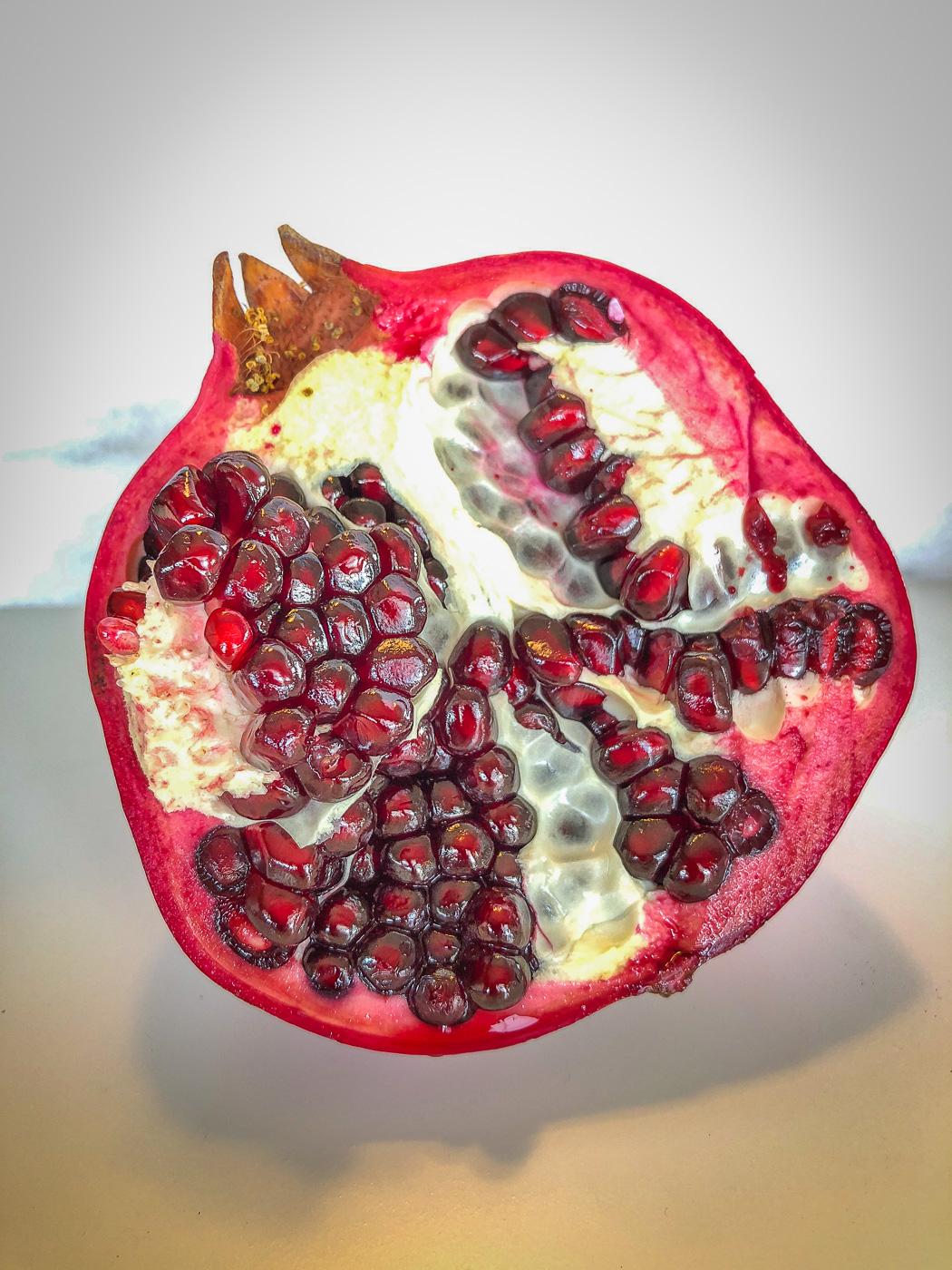 Close up shot of half a pomegranate, cut