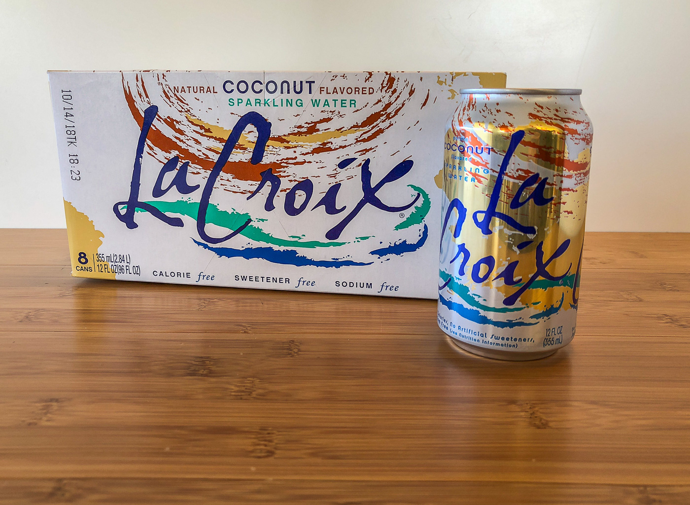Can of coconut LaCroix next to the box/case