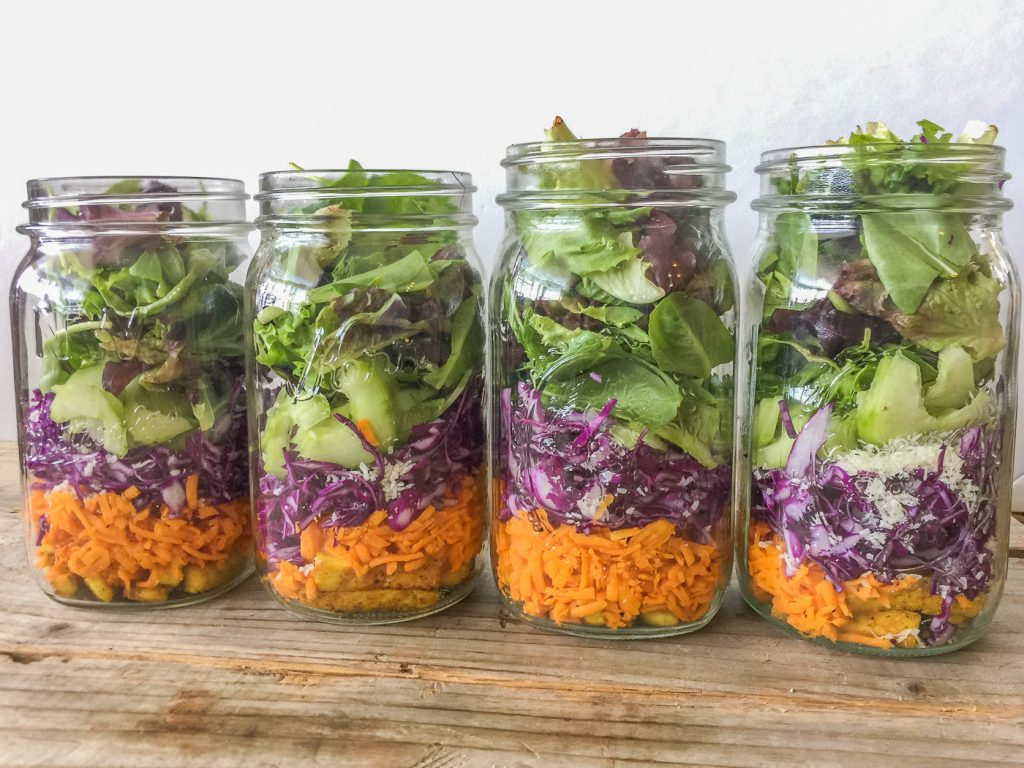 4 quart mason jars layered with vegetables
