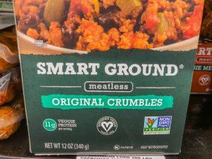 Close up of a vegan stamp/symbol on a package of meatless burger crumbles