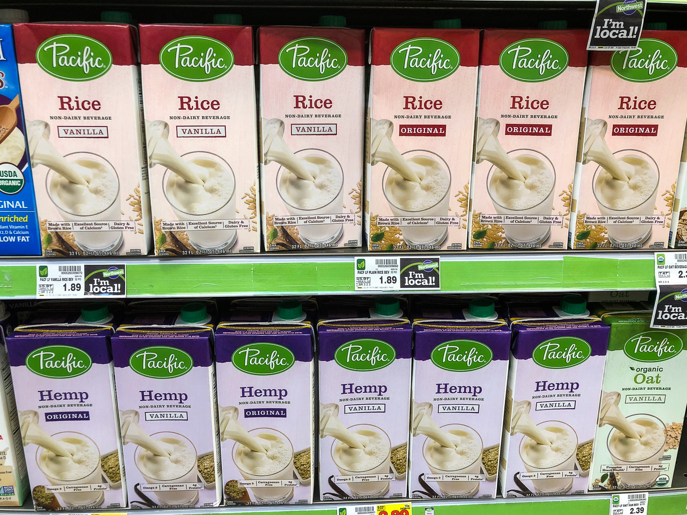 Grocery store shelf of boxes of rice and hemp milk