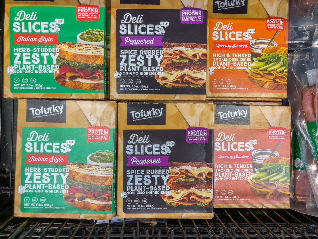 3 different packages of meatless deli slices