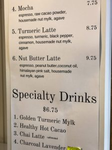 Menu board with listing of menu items including specialty drinks