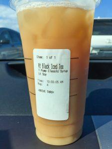 Starbucks cup on dashboard
