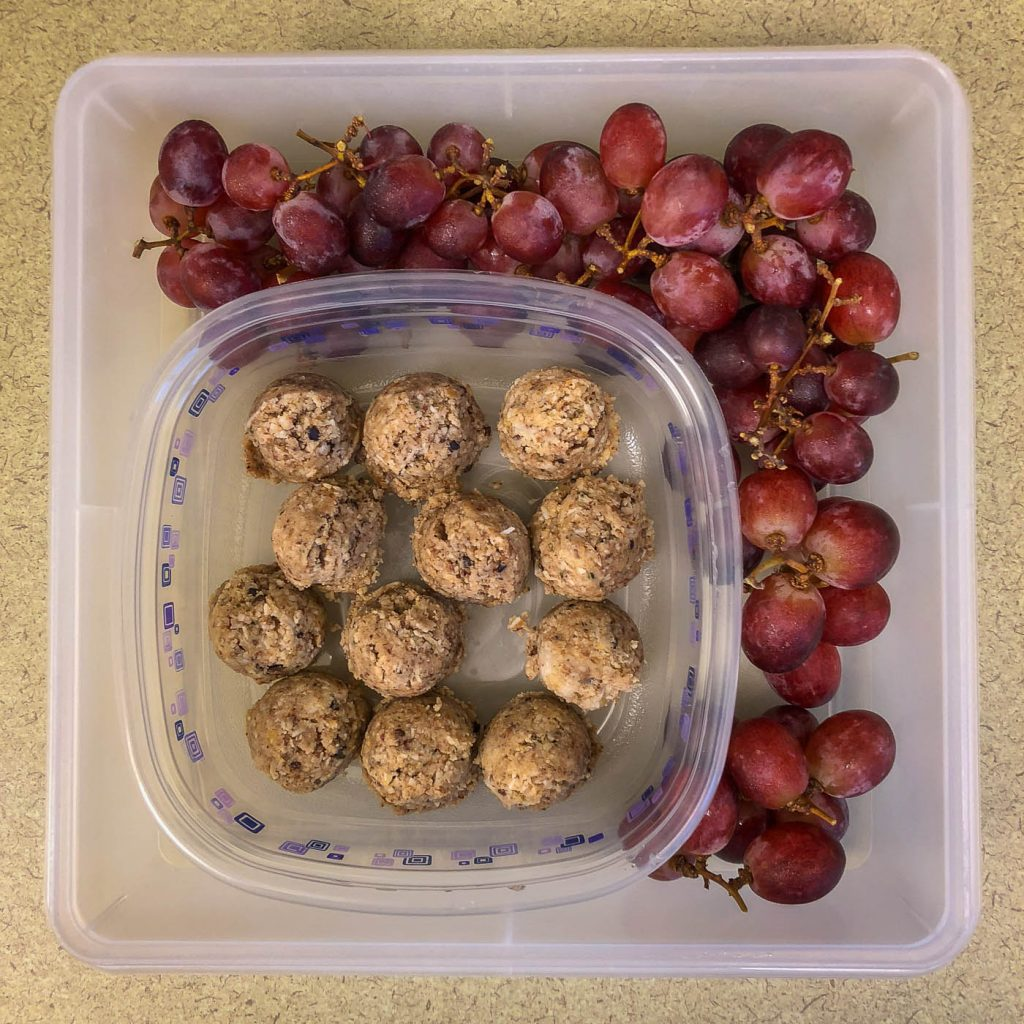 Plastic container with grapes and energy balls