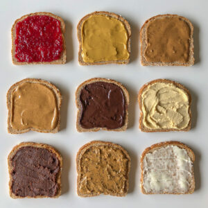9 pieces of bread each covered with a different spread