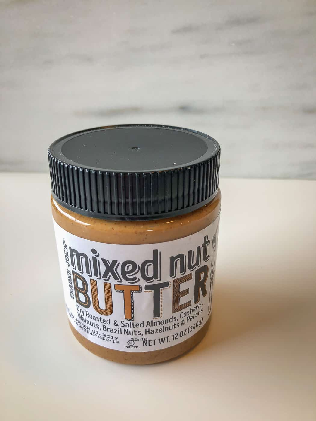 A jar of mixed nut butter