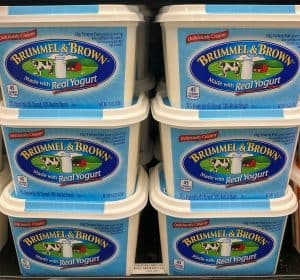 6 tubs of margarine on a grocery store shelf