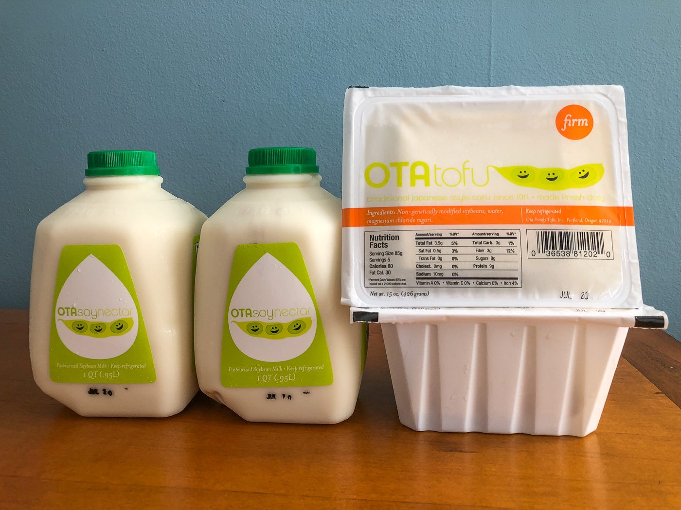 Two cartons of soymilk and two packages of tofu