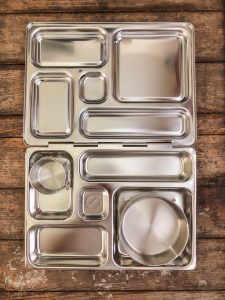 Metal lunch box with compartments