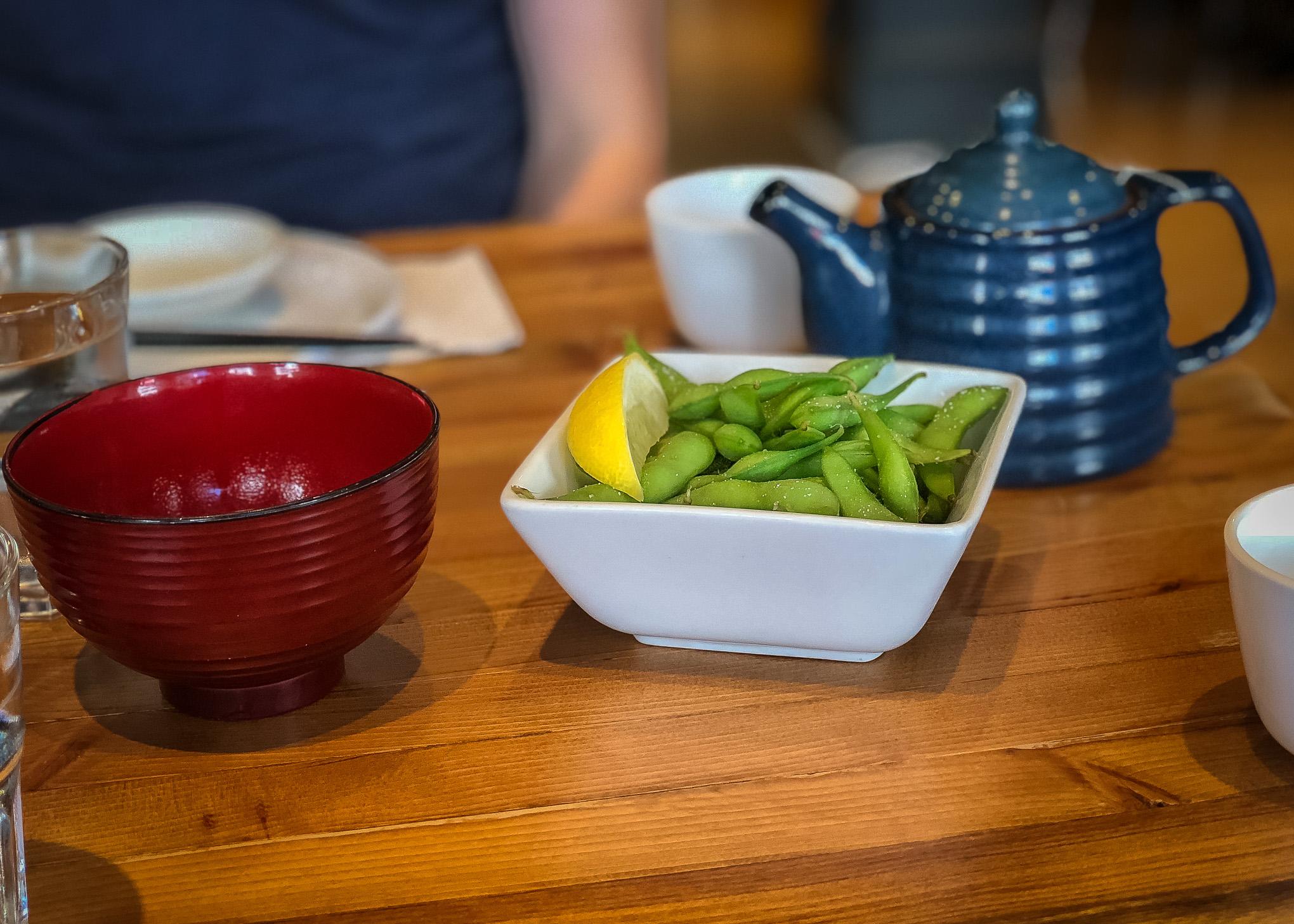 White bowl of edamame pods