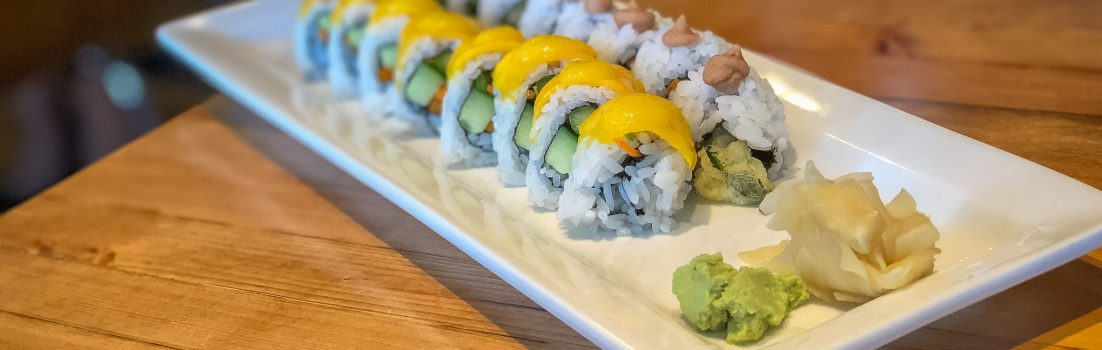 Oblong late covered with sushi rolls