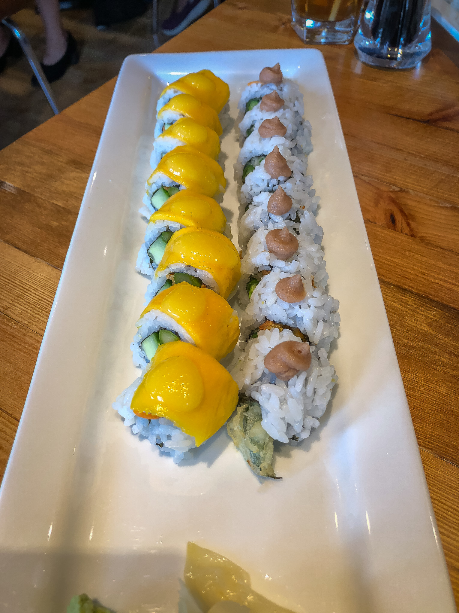Oblong plate filled with sushi rolls
