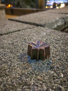 Piece of chocolate shaped like a maple leaf