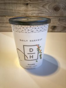 Paper cup with smoothie ingredients inside