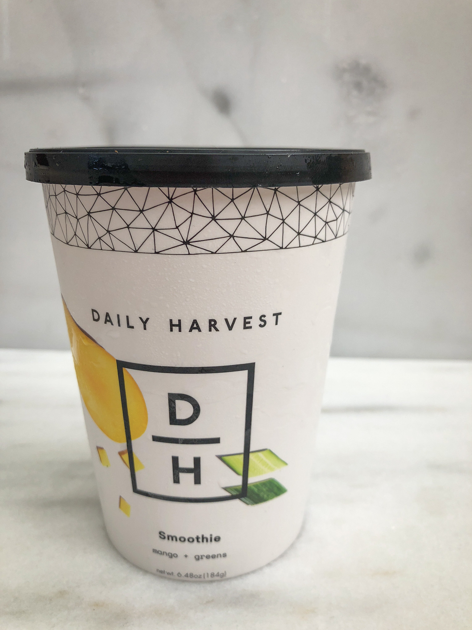 Paper cup with smoothie inside