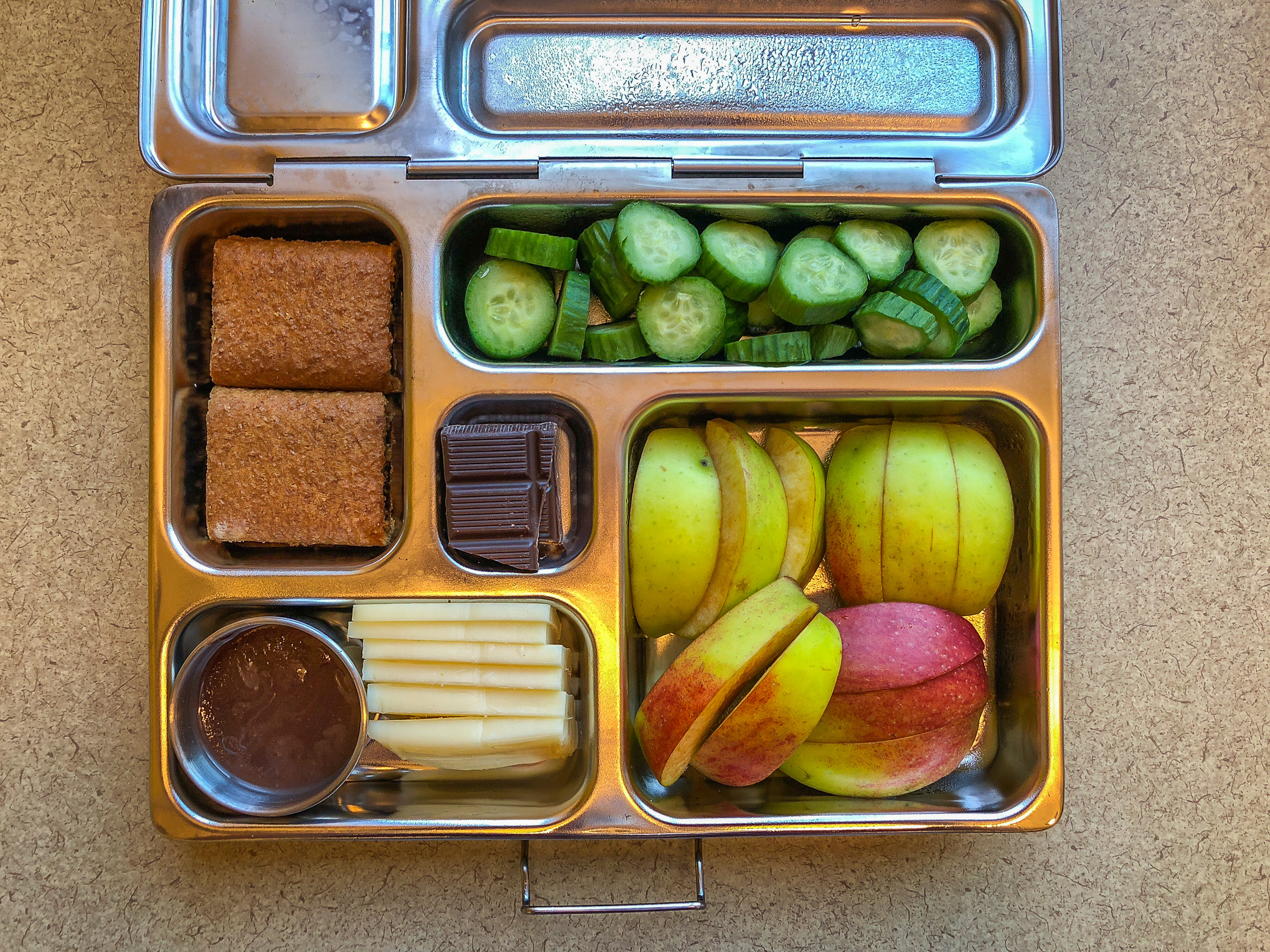 Bento box filled with vegetables and fruit