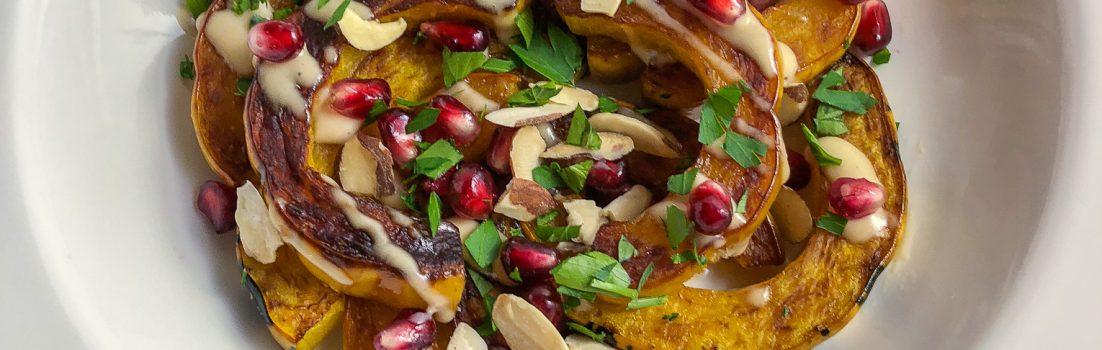 Delicata Squash with pomegranate, parsley and almonds
