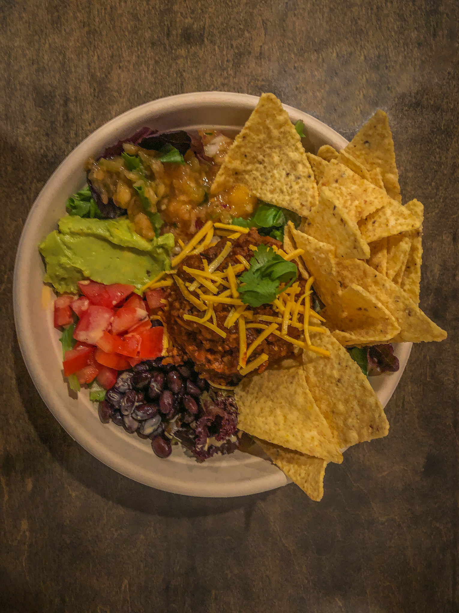 Bowl of taco salad with tortilla chips