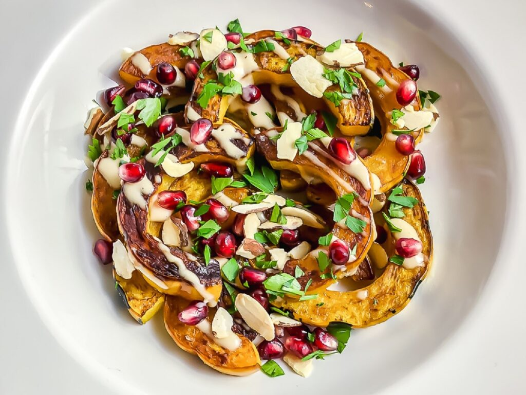 Plate of delicata squash with pomegranate