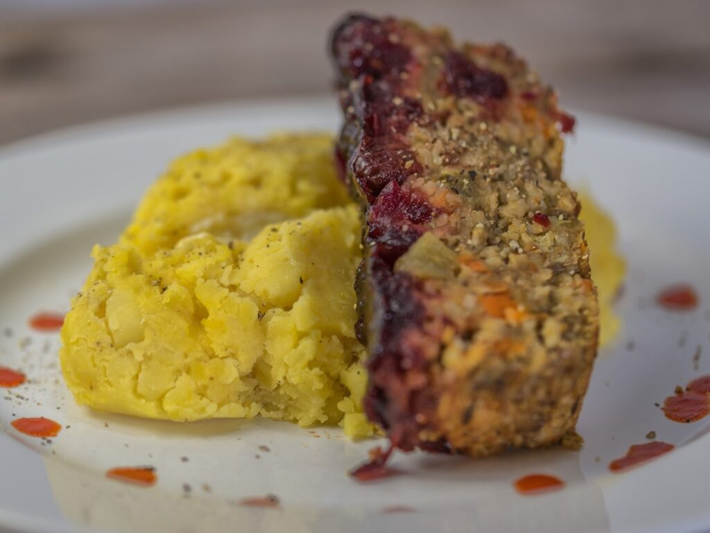 slice of lentil loaf with mashed potatoes