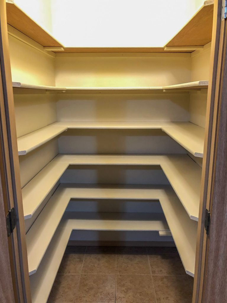 Pantry with painted shelves