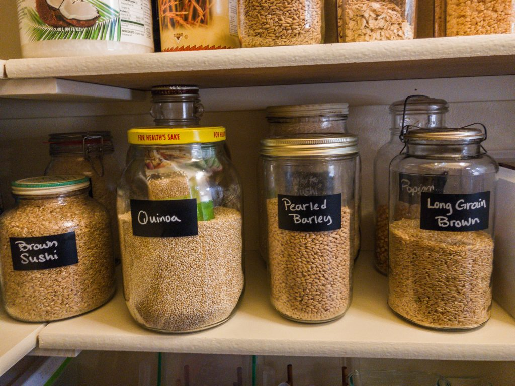 Glass jars filled with whole grains