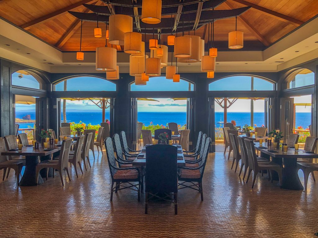 Tables and chairs in a restaurant with an ocean view