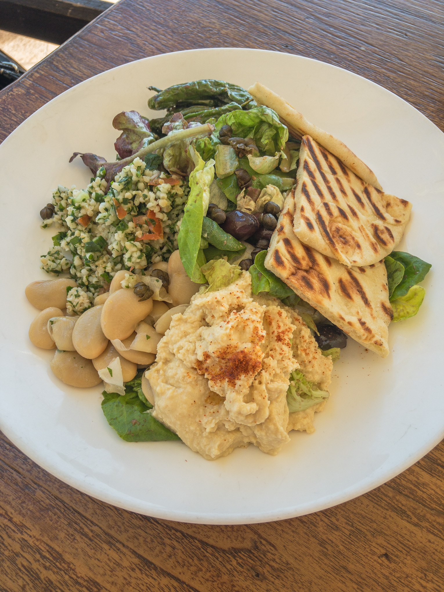 Bowl with hummus, pita and butterbeans