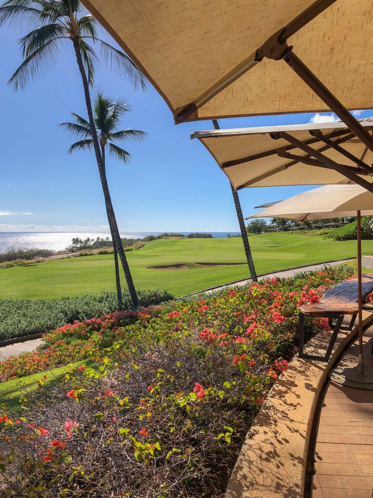 Flower bed, golf course, and ocean view