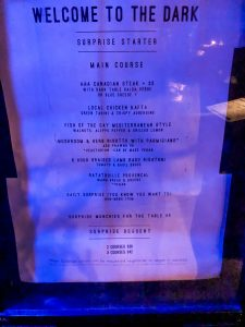 Picture of a menu in a glass case