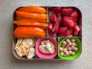 Bento box filled with bell pepper and strawberries