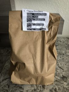 Paper bag with food order stapled to the front