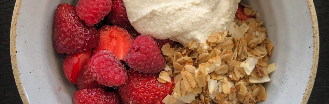 Bowl of granola, berries and coconut yogurt