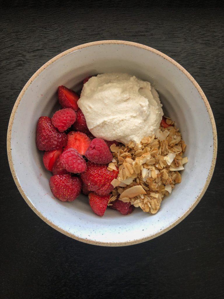 Bowl of granola, berries and coconut yogurt