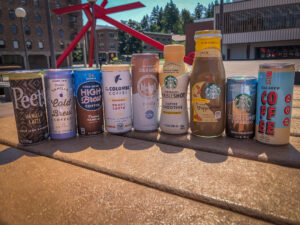 Cans of iced coffee on a picnic table