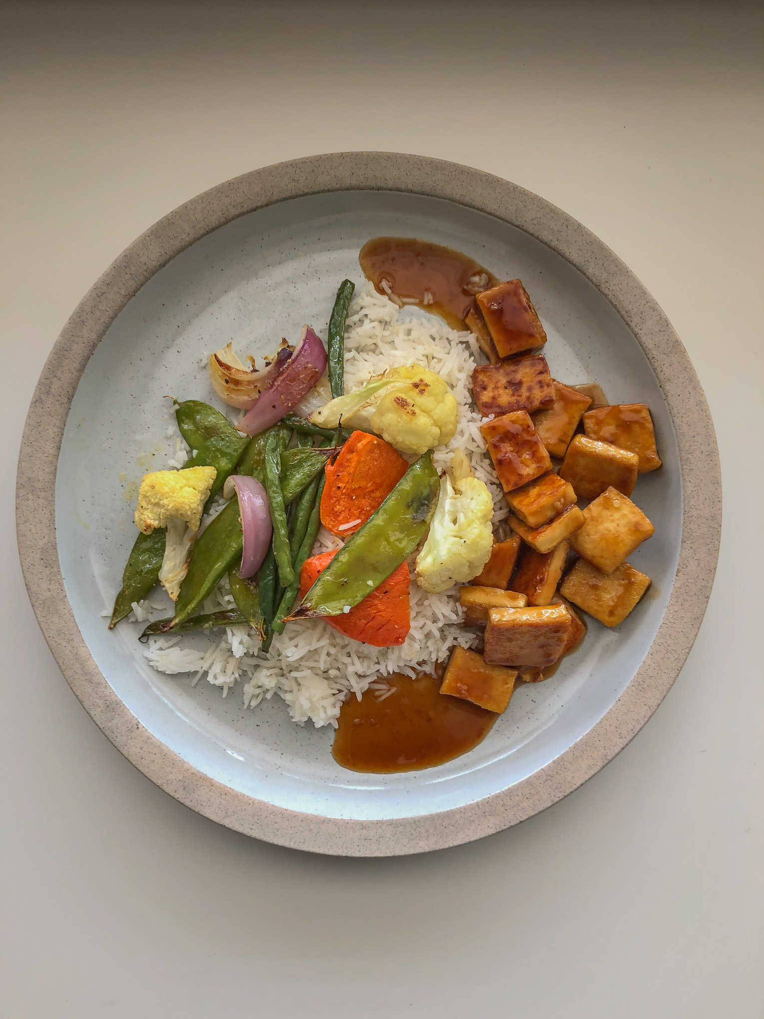 Tofu, veggies and rice on a plate