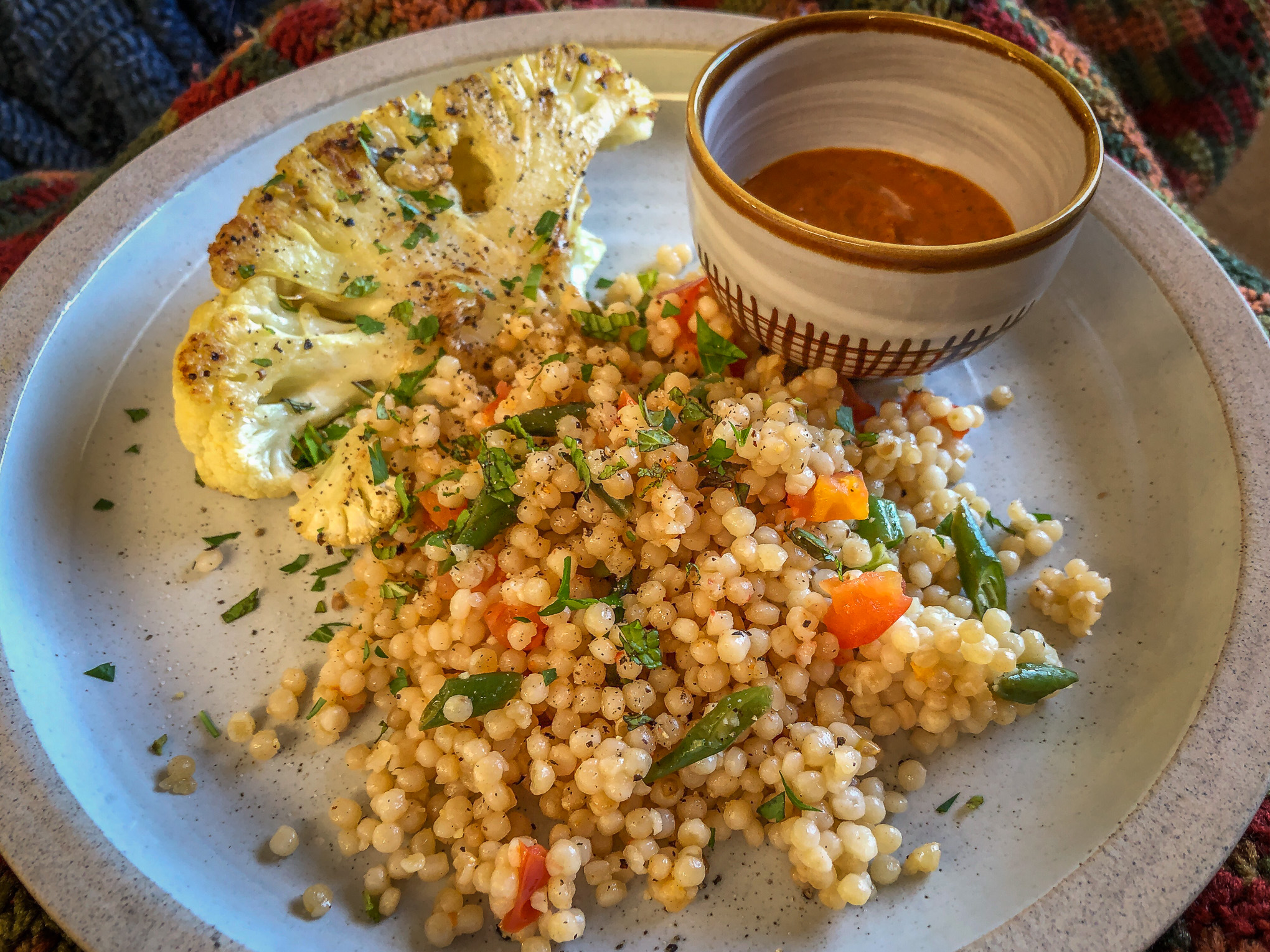 Couscous, cauliflower on plate