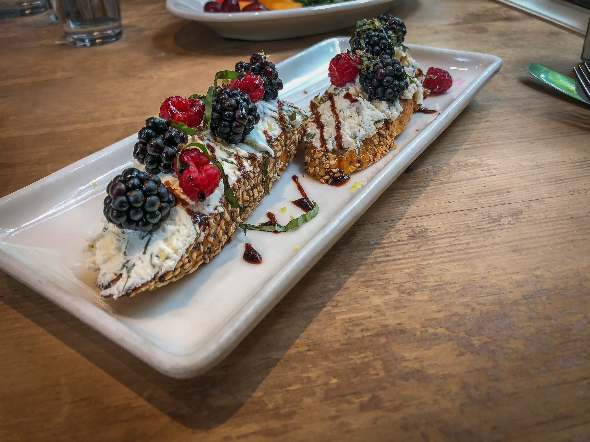 Bruschetta on a plate topped with berries