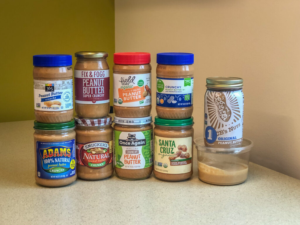 10 jars of peanut butter stacked