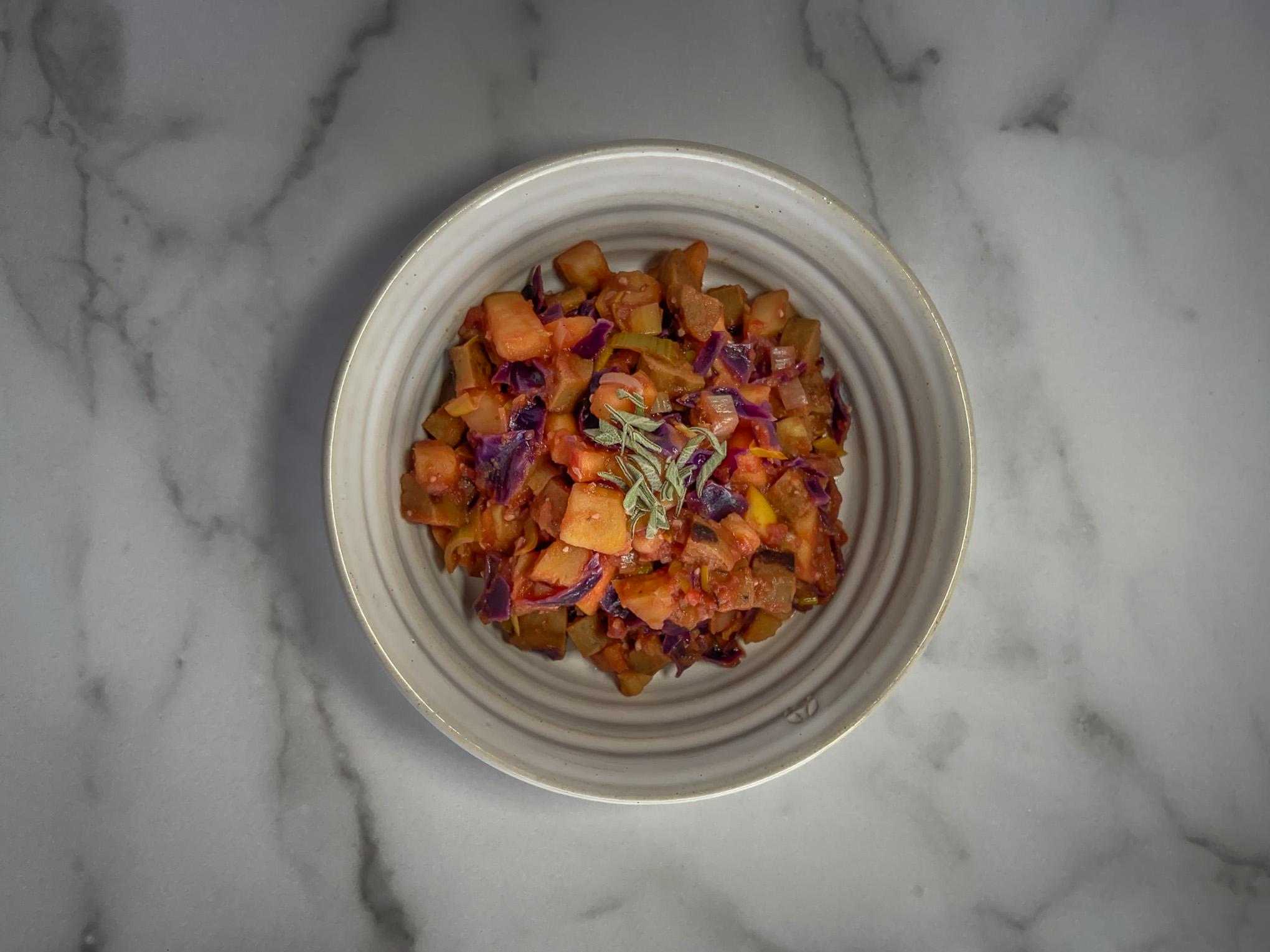 Bowl of vegetarian sausage and veggies