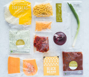 Top down view of a bunch of ingredients for a dinner kit meal