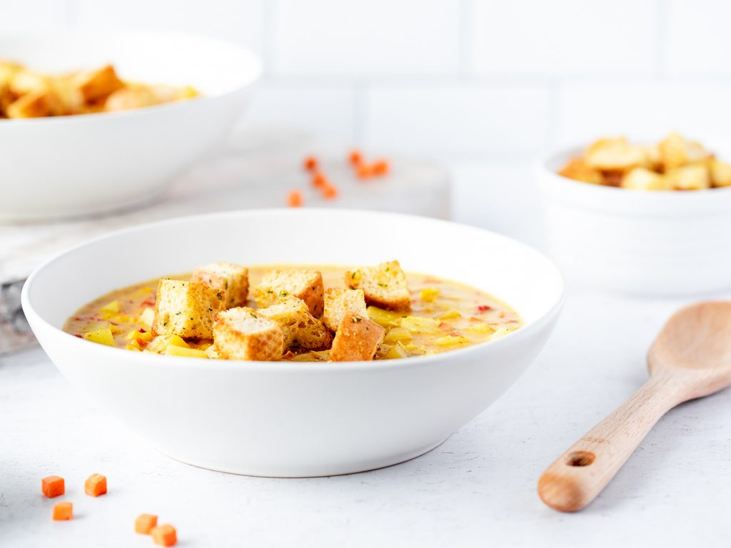 Bowl of corn chowder with croutons