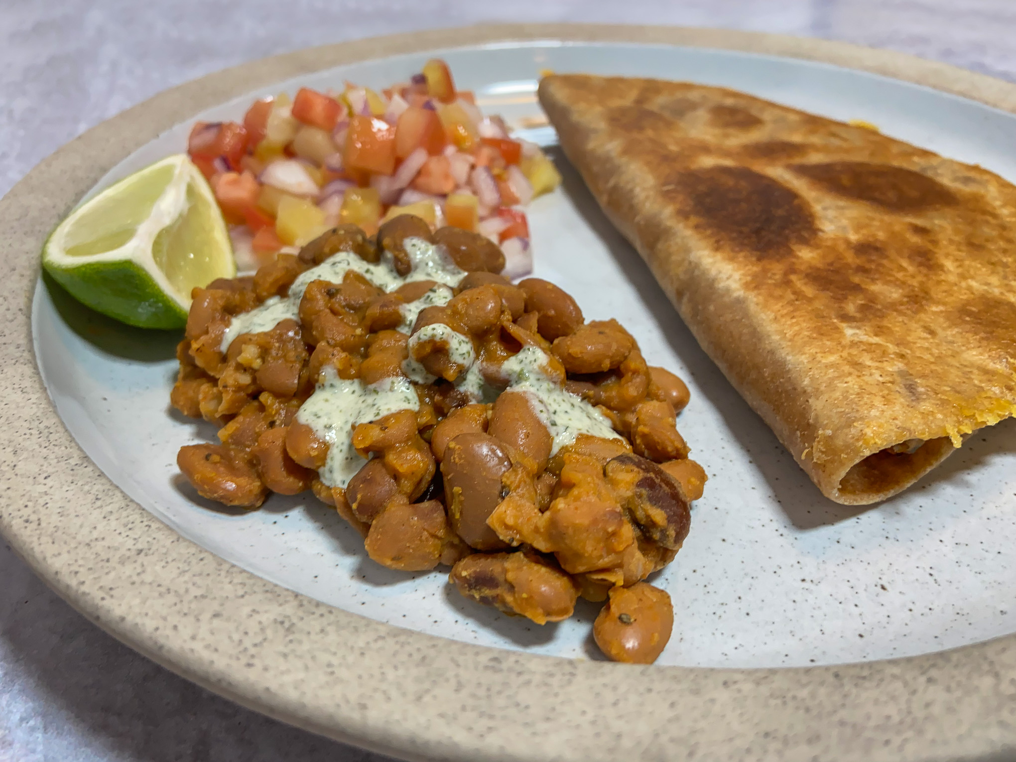 Plate with beans, salsa and quesadilla